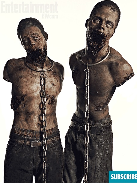 Moses J. Moseley (left) as Michonne's pet walker.