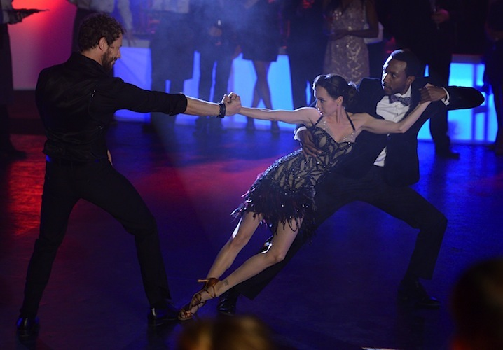 Ksenia shows off her tango skills with Kris Holden-Ried and KC Collins. Image Source: Showcase